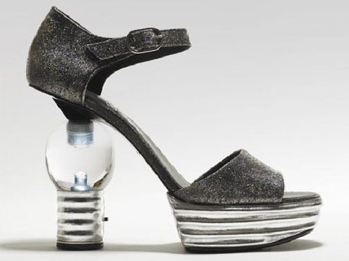 No need for a flashlight. Chanel's light bulb heel can do the job!