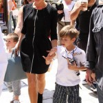 Victoria Beckham zips up for a day in the sun