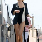 Eva Herzigova works a retro one-piece in Cannes
