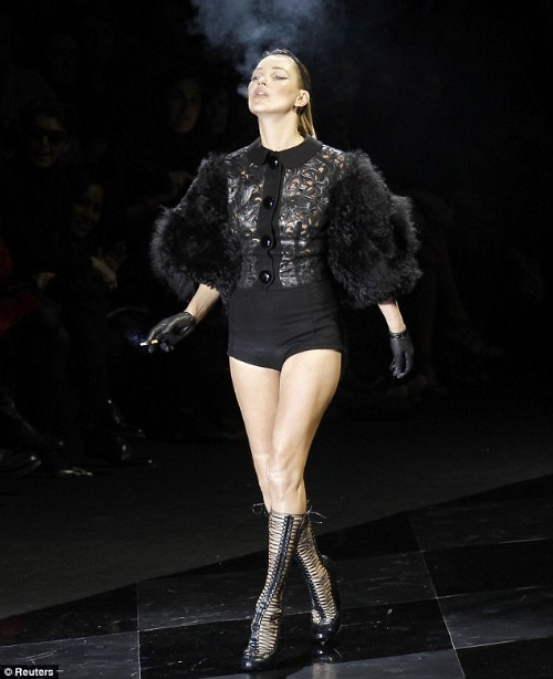 Kate Moss lights up on the catwalk
