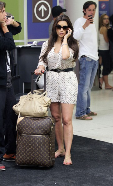 Kim Kardashian does Louis Vuitton airport chic
