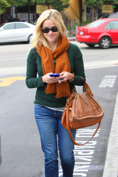 reese witherspoon gives up snakeskin python chloe bag