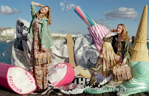 Frida Gustavsson and Lindsey Wixson pose on Brighton beach for Mulberry's spring/summer 2012 campaign