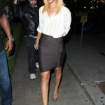 A newly-blonde Rihanna channels her inner sexy secretary in LA