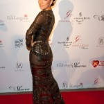 Are you a fan of Eva Longoria's metallic, sheer Reem Acra dress?