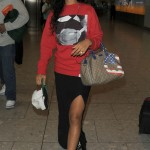 Rihanna lands in London wearing a cannabis jumper