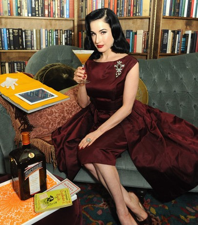 Dita von Teese wears vintage maroon dress at Cointreau launch