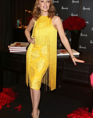 All attention on Kylie Minogue in yellow Stella McCartney