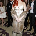 Lindsay Lohan tries (and fails) to channel Elizabeth Taylor in gold dress