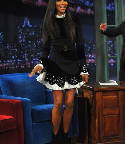 Naomi Campbell shows a lot of leg on Jimmy Fallon