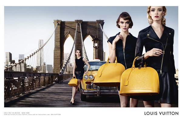 Karlie Kloss and Daria Strokous pose with Louis Vuitton's Alma bag for SS13 campaign