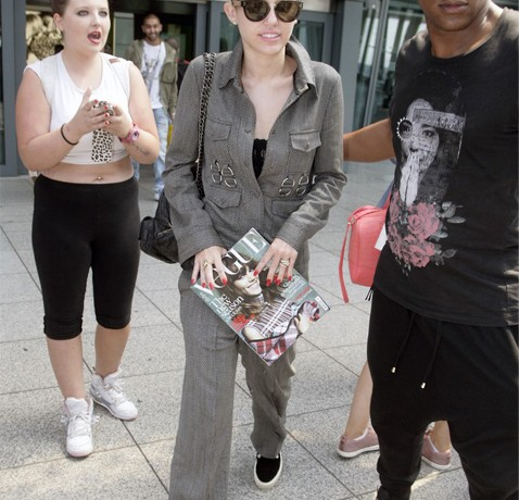 Miley Cyrus covers up in chic Stella McCartney at London's Heathrow Airport