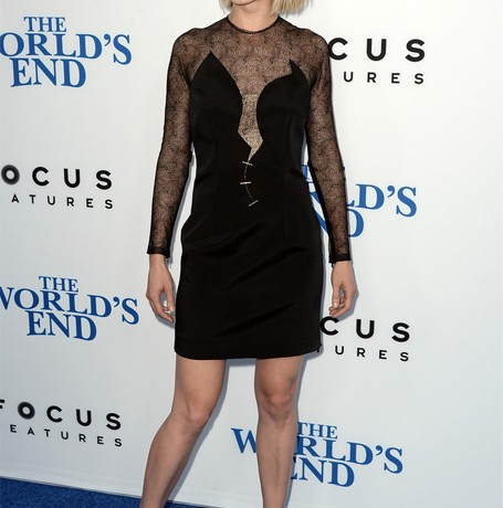 Rosamund Pike is sleek and sexy in Marios Schwab
