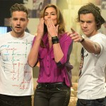 Cindy Crawford gives the One Direction boys a lesson in catwalking
