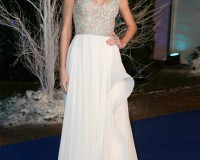 Taylor Swift does her best Kate Middleton impression in Reem Acra and Jenny Packham
