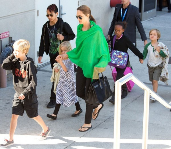 Angelina Jolie is all smiles in bold green pashmina