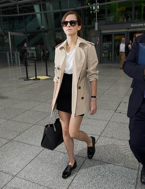 Emma Watson does casual airport chic in Sandro and Burberry
