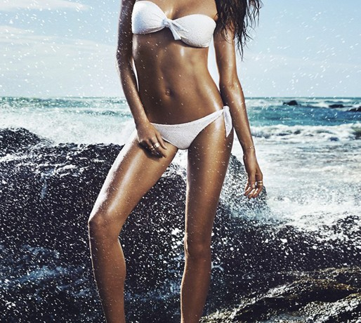 Gisele slips into her white bikini for new H&M ads, sings Blondie