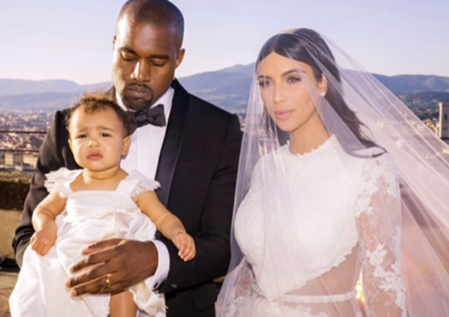 Look how cute little North West is in her Givenchy bridesmaid dress!
