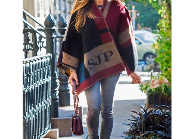 Sarah Jessica Parker works the Burberry check print poncho in New York
