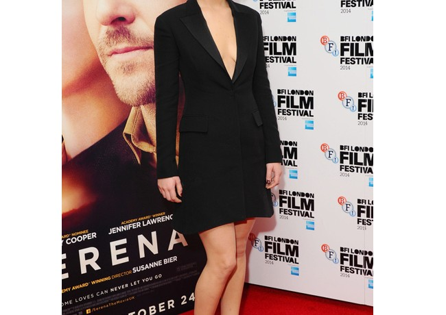 Jennifer Lawrence sexes up the coat dress at Serena premiere
