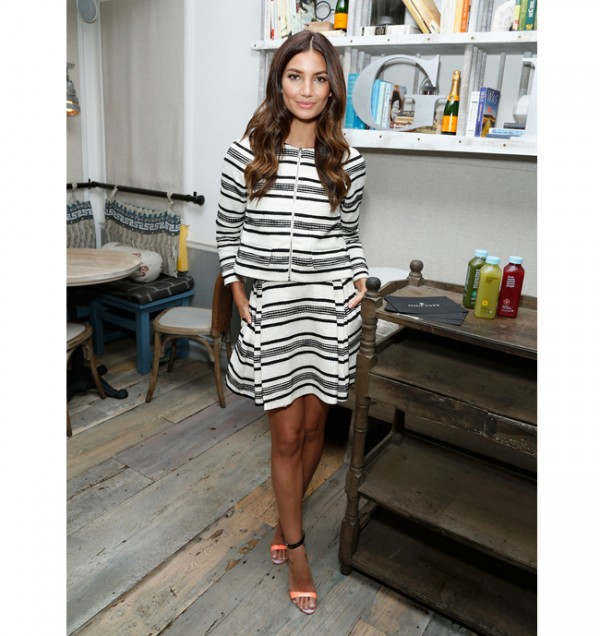 Lily Aldridge adds a hint of colour to her Thakoon ensemble with Sophia Webster sandals