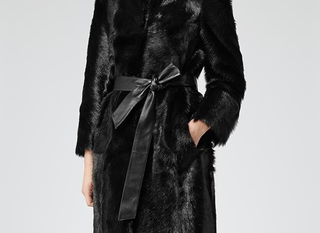See the winter through in style with this luxurious ombre shearling coat
